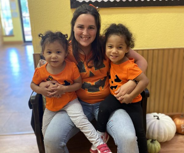 Ms. Brandi and her two little pumpkin twins on Halloween!